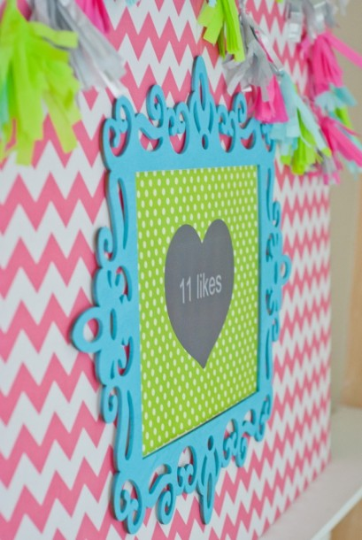This backdrop is such a cute idea. I love the frame, and of course, the tassel banner.